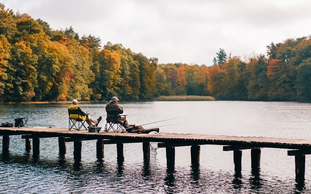 fishing in the fall near a mountain